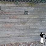Pressure washing a retaining wall