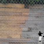 Powerwashing a retaining wall